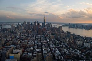 One World Trade Center stands the Lower Manhattan skyline at dusk in this aerial photograph taken above New York, U.S., on Friday, June 19, 2015. The Standard & Poor's 500 Index fell, with the gauge dropping below its price for the past 50 days, while Treasuries retreated. Photographer: Craig Warga/Bloomberg via Getty Images